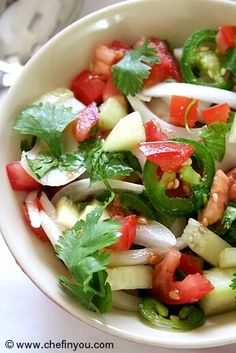 Ingredients  1 onion, thinly sliced  1 cucumber, peeled and chopped  1-2 jalapeno chillies (optional, as per taste)  2 medium tomatoes, chopped  1/2-1tsp roasted cumin powder (as per taste)  Juice of 1 lemon along with zest, as per taste  Some cane sugar for sprinkling  Salt to taste