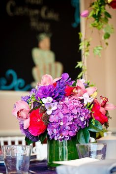 Jewel tones in floral arrangements and glassware make an impact for your fall wedding or event