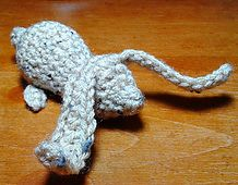 This cute little bunny is crochet all in one piece - no seaming, no parts to sew on. You can spiff him up with the addition of eyes, nose, etc. but please be aware that this will make the little fella less pet and child safe. As always, even when made as shown, supervise children and pets who don't know not to try to eat a yarn critter :-)