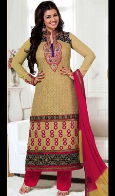 Ayesha Takia in buttercream georgette palazzo dress makes you center of attraction of everybody's eyes just like her. The dress is ornamented with woven lace, silk thread embroidery in the hem and neckline, mandarin collar and embroidered appliqued floral motifs. The contrast buttercream and pink chiffon shaded dupatta has woven lace. The dress comes with contrast pink shantoon palazzo. #BollywoodFashionableDress