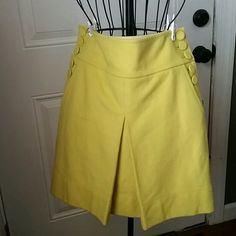 J CREW wool mini skirt sz 2 Color is a deep lime green, size 2, buttons up either side with pockets as well, pleat in the front, back is plain. Skirt is wool, and lined. Smoke and pet free home  Please feel free to ask questions, or request additional photos  Don't forget to bundle for discounts! J. Crew Skirts Mini