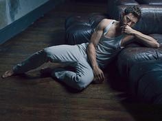 Jamie Dornan (DETAILS February 2015)  Tank top by Dolce & Gabbana. Jeans by Tod's.
