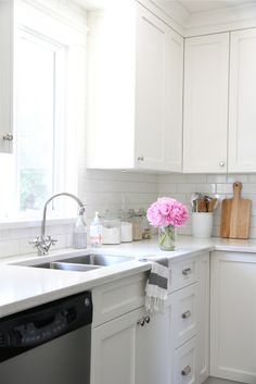 Cabinets Benjamin moore cloud white, subway tile from home depot, flextile grout in bone, quartz countertop, restoration hardware pulls,wall color is intense white (BM)