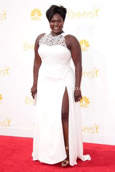Danielle Brooks The actress better known as Taystee, OINTB's resident math whiz and blonde weave-lover, steps out in a form-fitting white gown with a dramatic netted bodice — and a thigh-high slit to rival anything at the VMAs.
