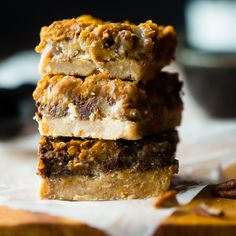 These pumpkin spice paleo magic cookie bars are a healthier, gluten free version of the classic dessert that are packed with spicy-sweet fall flavors!