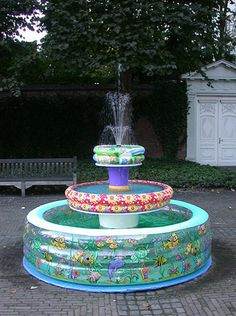 """kitsch courtyard featuring """"fontaine de le cou rouge"""" (redneck fountain)...hehehe, love it!"""