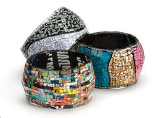 Bracelets made out of recycled magazines.