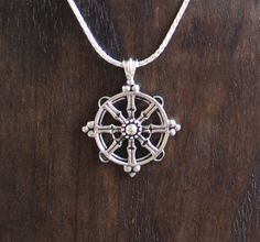 Dharma wheel from Uproar Jewelry - Bonus: Part of the profits go to big cat conservation causes