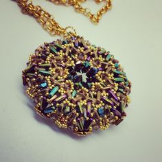My Urania Pendant. A 18 mm. rivoli bezeled and decorated with Triangle Beads, Tribeads, Bicone and Seed Beads. My pattern. 2015