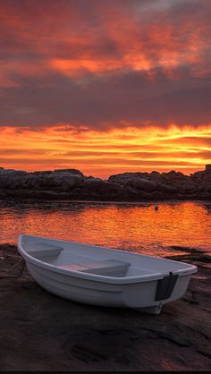 Boat At Cape Neddick, Maine. Red Sky Ocean Sunrise. Photo By: Kim Seng   Source Flickr.com