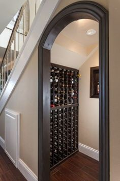 wine room under stairs - love the concept....