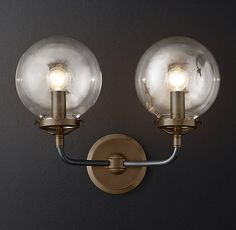 RH Modern's Bistro Globe Clear Glass Double Sconce:Inspired by 1940s industrialism, our globe sconce's lines and spheres are reminiscent of an urban subway map.