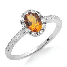 A pretty oval shaped citrine gemstone sits bezel set in the center of this 14k white gold band. The citrine gemstone is surrounded by baguette prong set diamonds and round prong set diamonds climb down the band. The diamonds have G/H color and SI1/SI2 clarity.Different ring sizes may be available. Please inquire for details. $277.00