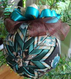 Teal Brown and Gold Quilted Star Christmas Ornament.