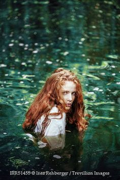Trevillion Images - red-haired-woman-in-water