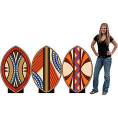 These African Shield Standee Set features orange, brown, blue and ivory tribal designs on these shields.