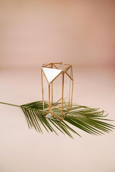 2019 event and wedding trend! These geometric glass lanterns are perfect for floor or table decor. Add candles, flowers and greenery for a dramatic effect. These made with a high quality and are gold in color. Large - Tall x Wide (shown in first photo) Candlestick Centerpiece, Candlestick Holders, Centerpiece Decorations, Candlesticks, Wedding Centerpieces, Tall Centerpiece, Wedding Decorations, Sequin Tablecloth, Glass Texture