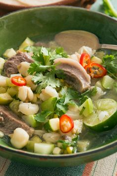 NYT Cooking: In most towns in Mexico, street vendors set up food stalls on summer evenings. Head for the pozole stand for bowls of brothy pozole verde, a stew of large hominy kernels simmered with pork. As opposed to pozole rojo, made with red chiles, this lighter, herby version makes a great summer supper. Set out bowls of condiments — chopped onion, cilantro, chopped chiles, avocado and oregano — so each diner can customize. A squeeze of lime for each serving is vital.