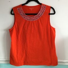 Coldwater Creek sleeveless top. Coldwater Creek bright orange top with pretty orange, white and pink braided neckline. Sleeveless for spring or could be worn under a jacket now for a pop of color. Size XL. Great condition. Coldwater Creek Tops