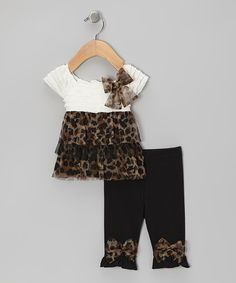 Rippling sleeves and a whimsical wildcat pattern make this set as sweet and stylish as can be! A half-button back and stretchy bow leggings lend to easy dressing and comfort for a day of play.Includes tunic and leggings96% polyester / 4% spandexLining: 100% polyesterMachine wash; tumb...