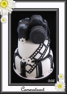 Camera Cake maybe for my hubby's birthday - but without the flowers (I think they are pretty but he may not lol)