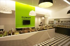 Dumon chocolatier shop by Witblad, Kortrijk – Belgium; beautiful colour and also use of colour and clean lines and lighting.a little sterile for my store but a very beautiful place Chocolate Boutique, Chocolate Shop, Commercial Interior Design, Commercial Interiors, Shop Front Design, Store Design, Chocolates, Retail Space, Boutique Design