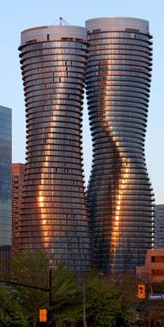Nicknamed the Marilyn Monroe Buildings (for their curvy shapes) Absolute World Towers in Mississauga, Ontario, Canada is a residential condominium twin tower skyscraper complex #architecture ☮k☮