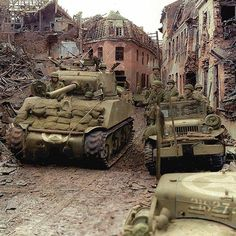 """the_ww2_archives M4A3 (76)'Sherman' of the 771st Tank Battalion, US 84th """"Rail -Splitter"""" Division after the fighting in ruins of the German town of Linnich. February 24 1945 On the right is an 'HQ' Dodge WC-52f (with what looks like 9th Armored Div markings on the fender) https://www.facebook.com/WW2-Colourised-Photos-393166910813107/ 'Operation Grenade' The Roer River rose to historical prominence in the winter of 1944/1945 when it became an integral part of the German western border…"""