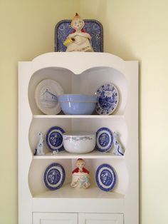 Corner cabinet with vintage dishes and pottery