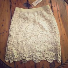 Lace skirt Cream lace skirt with zipper enclosure.  Really cute to dress up or down Dresses Mini