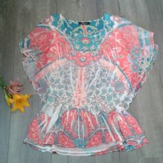host pick Must have blouse NWOT Very adorable blouse made of polyester. Semi see though, has two thin layers. Ruffle sleeves run down to waist line. Elastic waist and colored rhinestones along the top. NWOT Womens size M host pick 6/12 weekend wardrobe party Style & Co Tops Blouses