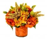 Yellow Heather and Orange and Yellow Hydrangea in Labeled Glass Pot