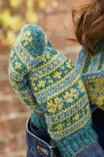 WORKING IN three tweedy shades of blue, teal and yellow, Mary Henderson has created pretty, traditional Fair Isle patterning for her winter accessories set. It comprises a cosy cowl, a hat, and a pair of mittens. Mary has knitted her set using a beautiful worsted-weight alpaca yarn from The Border Mill in Scotland. Yarn quantities given (one skein of each colorway) will make all 3 projects.
