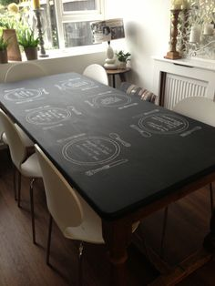 My newly painted blackboard table with permanent painted table settings & random quotes, I'm chuffed the way it's turned out ☺