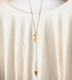 Long Arrow Brass Pendant Necklace | Hit the jewelry bullseye with this long pendant necklace. | Necklaces, $25