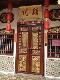 """The """"Pintu Panjang""""front door/""""long doors to a Peranakan home with a tiled enterance veranda."""