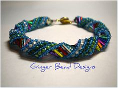 This is a Russian Spiral bracelet featured in the October 2011 Bead & Button magazine. I chose multi-colored bugle beads and size 11 seed beads in 2 shades of green and white and size 15 seed beads in cobalt blue.