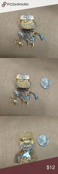 Noah's Ark brooch Fun Noah's Ark brooch. Gold and silver metal material.  Cute animals: dove, cat, bear, elephant, zebra, butterfly, turtle, umbrella, star. Lots of fun to wear on sweater, scarfs, jackets. n/a Jewelry Brooches