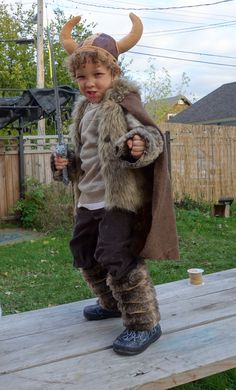 Homemade Viking Costume - fake fur wrapped with leather cording around legs. Tan shirt, brown pants and a fun cape with fake fur.
