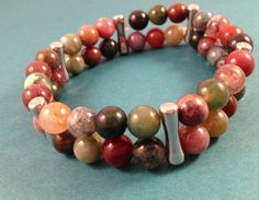 Beautiful earth tones abound in this natural African Jasper stone bracelet.