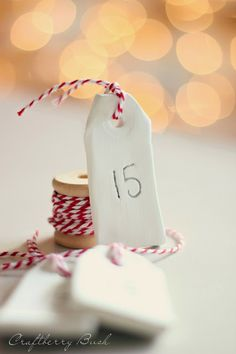 Advent calendar tags made of clay.  The edges could be textured using embossing plates or a tool of some kind to add a little more interest.  And they can be painted with a wash too.  Pretty simple and pretty cute.