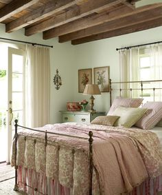 An exposed ceiling, like in this Catskill Mountain house, helps to create a homey feel.%0A  - ELLEDecor.com