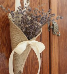 Khaki burlap pew cone / rustic wedding decor by NutfieldWeaver. $10.00, via Etsy.