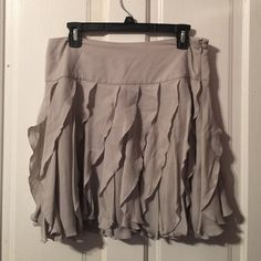 Grey ruffled skirt size 10 Grey ruffled skirt size 10. Length is 18 inches and width is 15 inches laying flat. Sid zippered closure. INC International Concepts Skirts