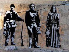 Blek Le Rat street art (self portrait of the artist in the middle)