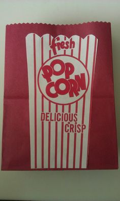Movie Theater themed birthday party- I copied a popcorn box, cut it out, glued it to a red paper bag and then trimmed the bag with design scissors =) Kids were served popcorn in these bags.
