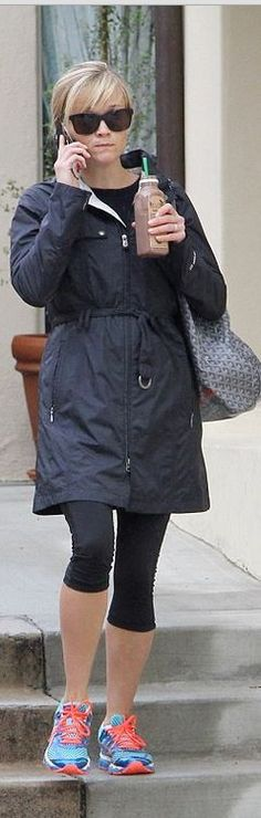 Reese Witherspoon's blue sneakers, gray handbag, and black coat