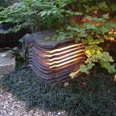 瓦の照明: 木村博明 株式会社木村グリーンガーデナーが手掛けた庭です。