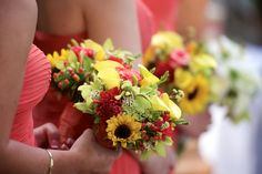 Coral bridesmaid dresses look even brighter when paired with vibrant bouquets. Desmond Charles Photography. Lyal Nickals Floral Design.