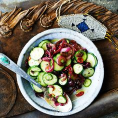 Cucumber And Charred Onion Salad | Somewhere between a condiment and a side; this would be great spooned right onto a burger.